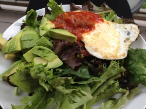Black bean veggie burger, egg, avocado, salsa, and greens.