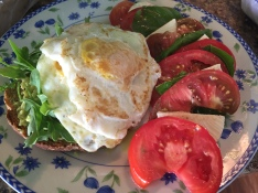 Avocado toast with fried egg and caprese salad